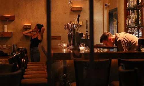 5 Irish Pubs to Visit in Canada man drinking bar - 5 Irish Pubs to Visit in Canada