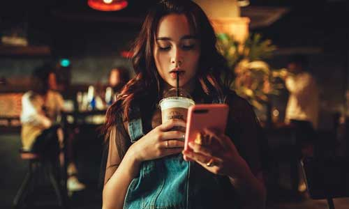 5 Things You Can Do in An Irish Pub woman phone - 5 Things You Can Do in An Irish Pub